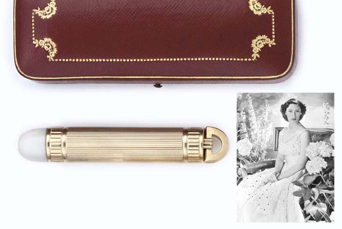 A GEORGE VI GOLD-MOUNTED TORCH