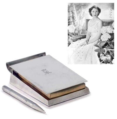 A SILVER DESK-JOTTER AND PENCI