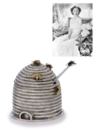 A PARCEL-GILT SILVER HONEY-POT