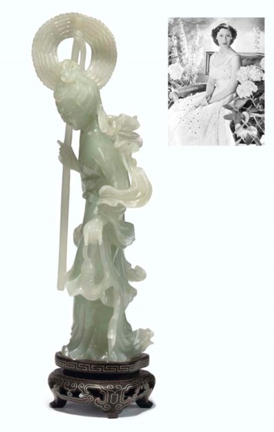 A CHINESE JADE MODEL OF A MAID