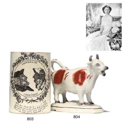 A STAFFORDSHIRE COW CREAMER