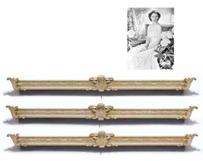 A set of three white and gilt-