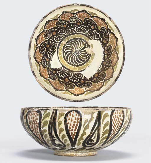 A SAMANID SLIP PAINTED POTTERY
