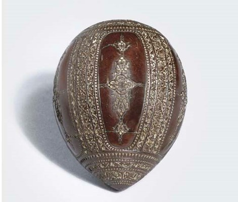 A NORTH INDIAN CARVED COCONUT