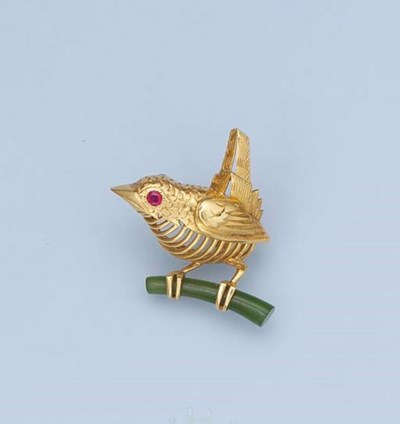 A GOLD NEPHRITE AND RUBY BIRD