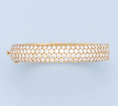 A DIAMOND BANGLE, BY VAN CLEEF