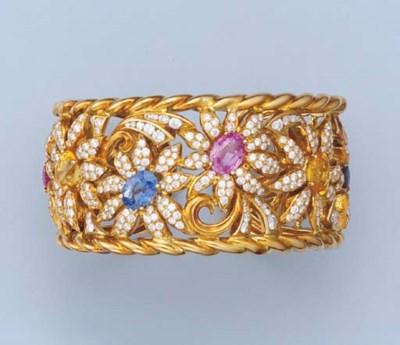 A DIAMOND AND SAPPHIRE BANGLE