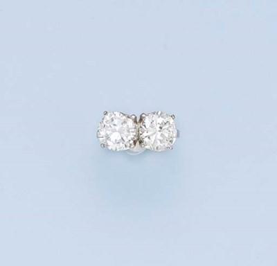 A DIAMOND TWO-STONE RING