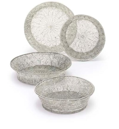A SET OF FOUR FILIGREE DISHES