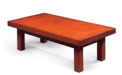 A SCARLET JAPANNED LOW TABLE