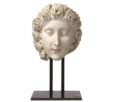 A CARVED MARBLE HEAD OF FLORA