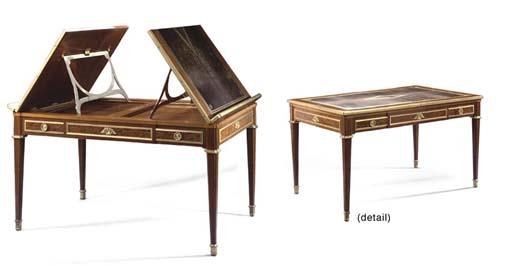 A Louis XVI style ormolu-mounted mahogany library-table