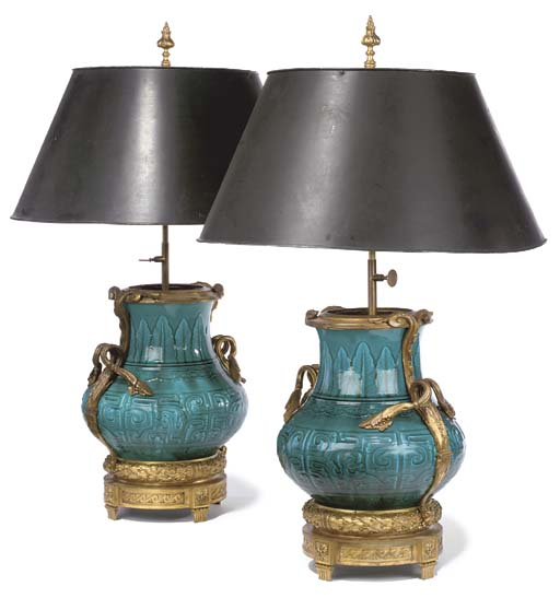 A pair of ormolu-mounted faience persian-blue-ground vases, mounted as lamps