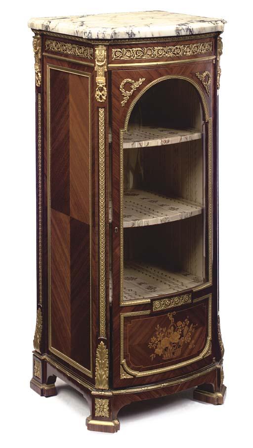 A Louis XVI style ormolu-mounted kingwood, mahogany and marquetry vitrine