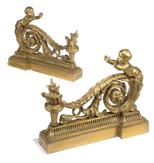 A pair of Louis XVI style ormolu chenets