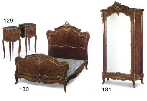 A pair of Louis XV style ormolu-mounted kingwood, tulipwood, marquetry and parquetry bedside cabinets