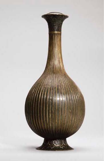 A SAFAVID BRASS AND SILVER OVE