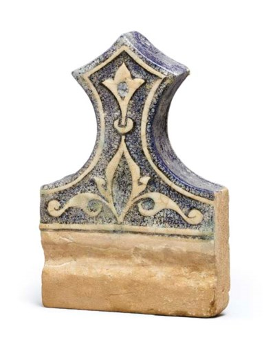 A KASHAN MOULDED BLUE AND WHIT