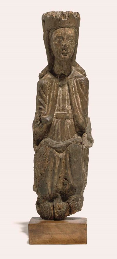 A CARVED WOOD FIGURE OF THE VI