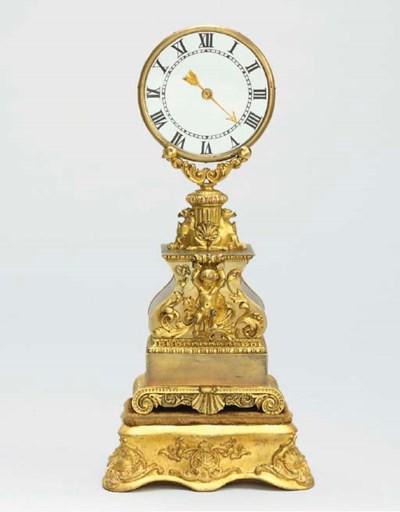 A Napoleon III brass, gilt-bra