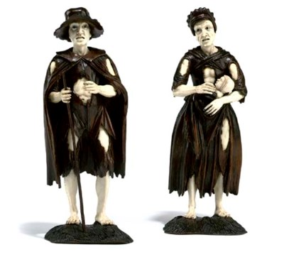 A PAIR OF AUSTRIAN CARVED IVOR