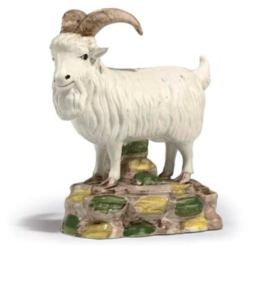 A PEARLWARE MODEL OF A GOAT