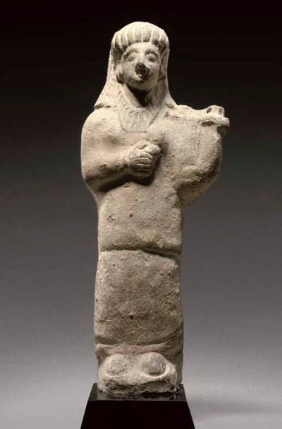 A CYPRIOT TERRACOTTA FIGURE OF