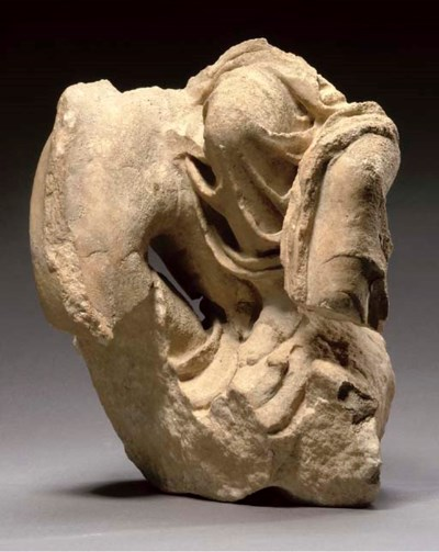 A ROMAN MARBLE FRAGMENT OF A N