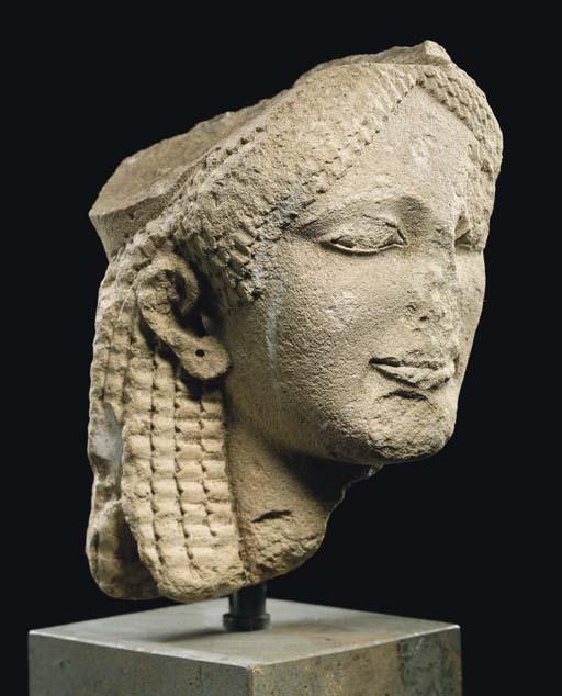 A GREEK LIMESTONE HEAD OF A KORE
