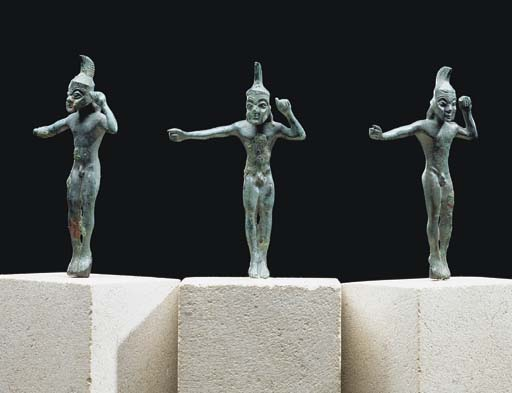 THREE LACONIAN BRONZE HELMETED WARRIORS
