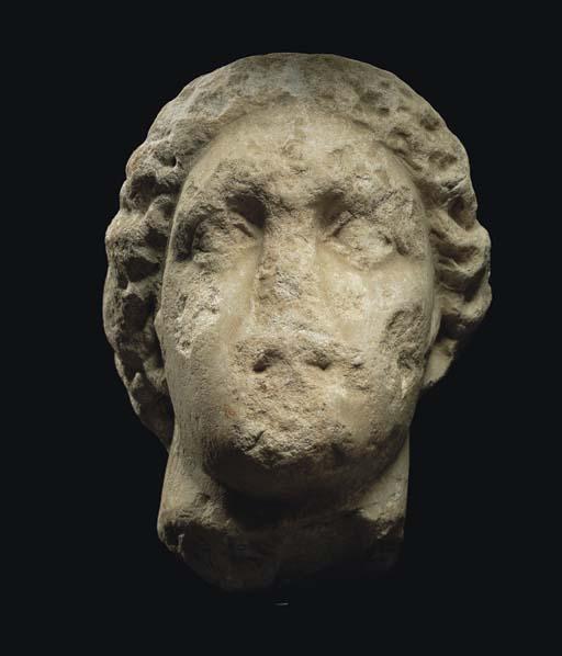 A GREEK MONUMENTAL MARBLE HEAD