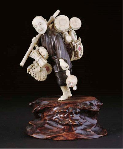 A Japanese ivory and bronze ok