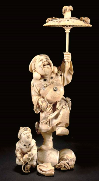A Japanese ivory okimono of Da
