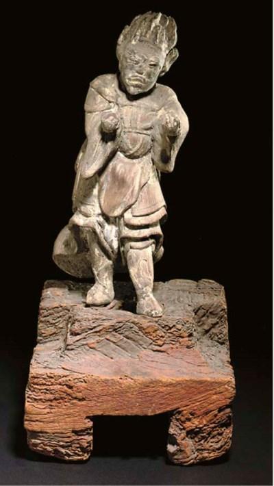 A Japanese wood figure of a de