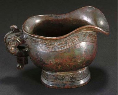 A Chinese bronze pouring vesse