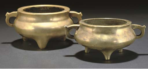Two Chinese polished bronze bo