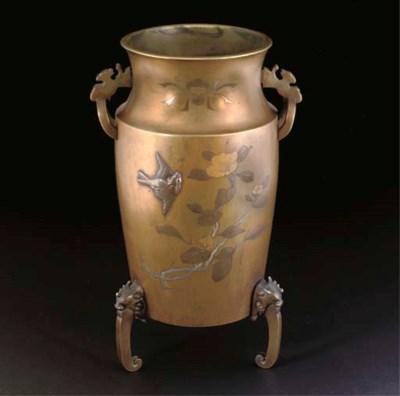 A Japanese bronze tripod vase,