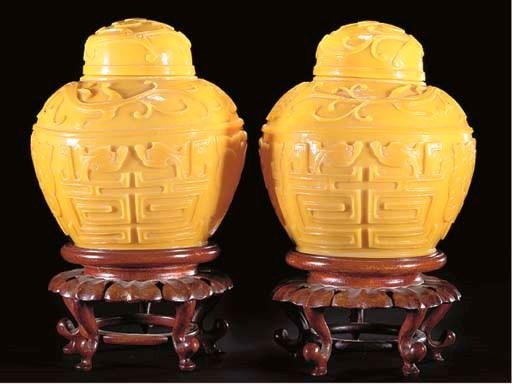 Two similar Chinese yellow Pek
