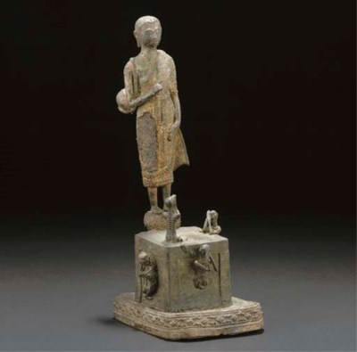 A Thai part gilt bronze group,