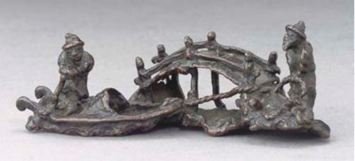 A Japanese small bronze group,