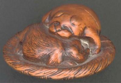 A Japanese wooden netsuke of a