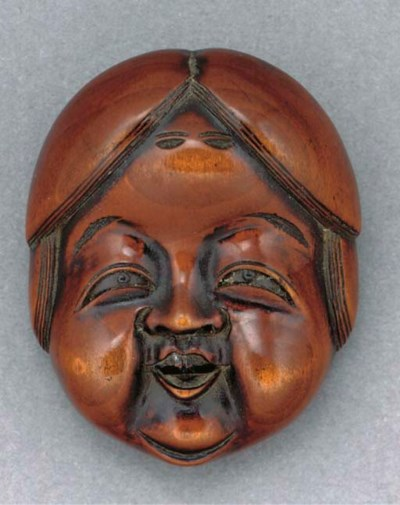A Japanese wood netsuke mask o