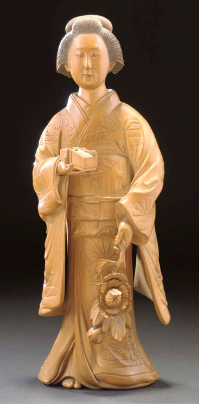 A Japanese wooden okimono of a
