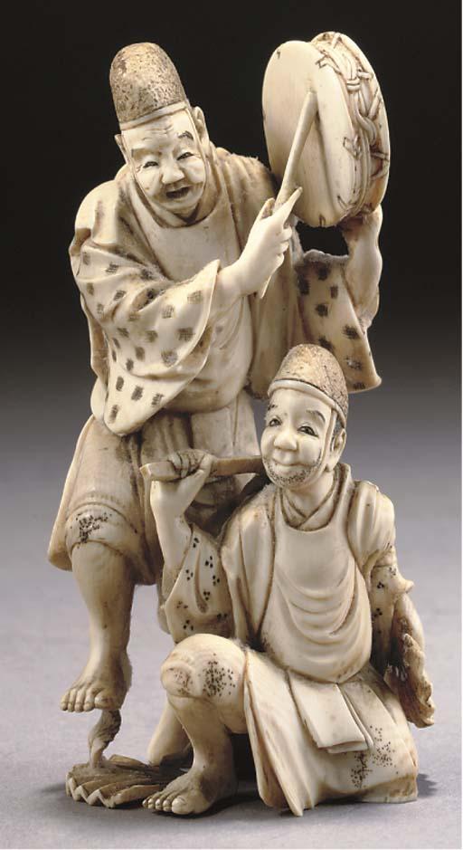 A Japanese ivory okimono of tw