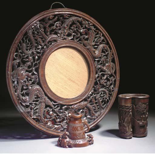A Chinese wooden circular mirr