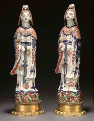 A Pair of Imari figures of lad