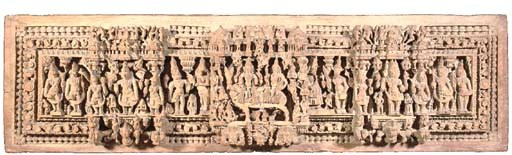 A LARGE CARVED WOODEN PANEL IN