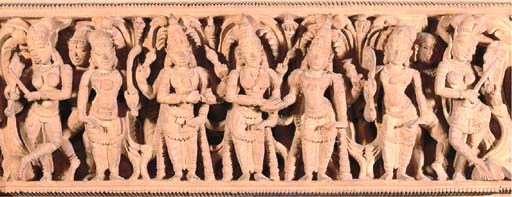 A LARGE CARVED WOOD PANEL FRIE
