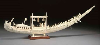 AN IVORY MODEL OF A BOAT NORTH