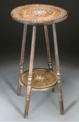 A circular two-tiered inlaid t